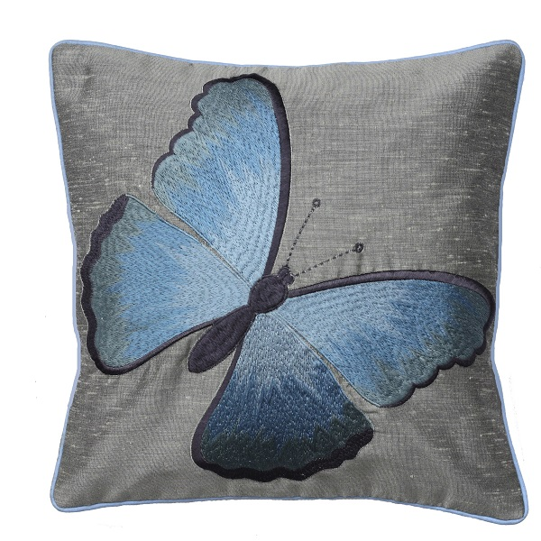 Cushion-Embroidered Butterfly on a steel Coloured Background